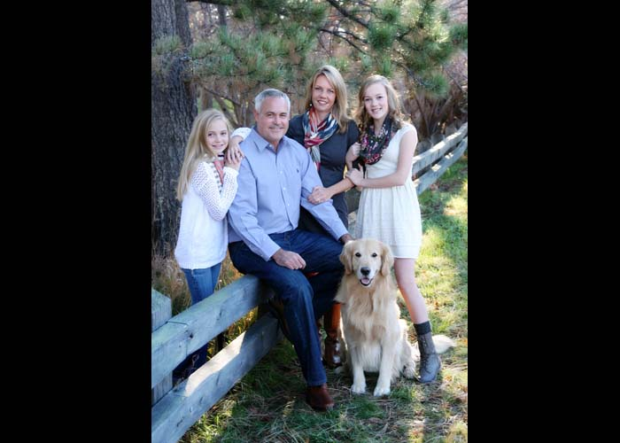 21-family_dogs_pets_golden_kids_teens_colorado_green_fall_leaves_fence.jpg