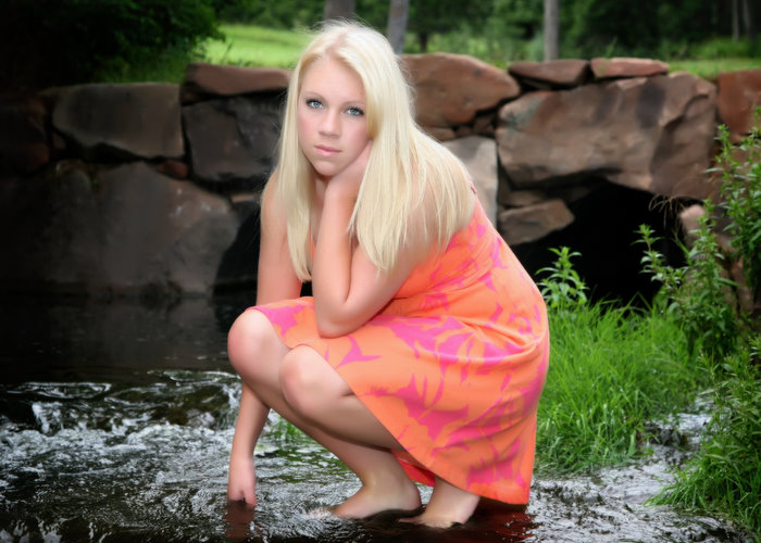 high_school_senior_girl_orange_dress_in_water.jpg