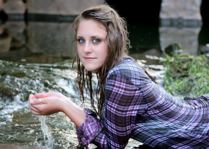 high_school_senior_girl_purple_shirt_in_water_bridge.jpg