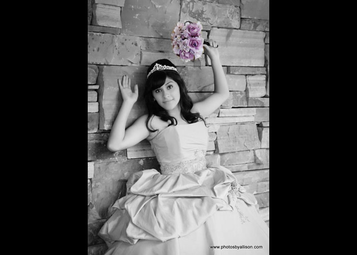 quinceanera_girl_wall_flowers.jpg