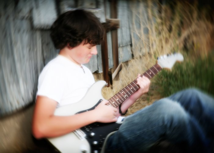 senior_boy_guitar_metal_shed.jpg