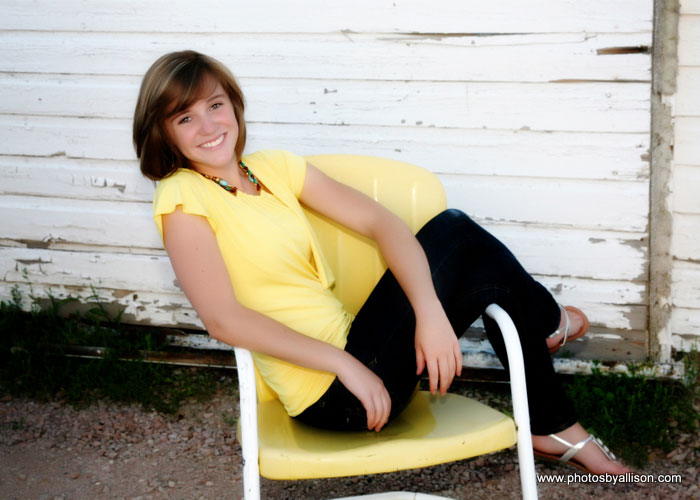 senior_girl_yellow_shirt_chair.jpg